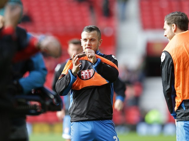 A very cold Jack Wilshere warms up ahead of the Premier League game between Manchester United and Bournemouth on March 4, 2017