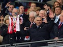 Manchester United manager Jose Mourinho celebrates with the EFL Cup trophy following his side's victory over Southampton at Wembley on February 26, 2017