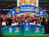 Manchester United players celebrate their EFL Cup final success over Southampton at Wembley on February 26, 2017