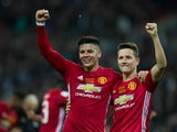 Manchester United duo Marcos Rojo and Ander Herrera celebrate after their EFL Cup final win over Southampton at Wembley on February 26, 2017