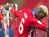 Manchester United midfielder Paul Pogba celebrates with the EFL Cup trophy following his side's win over Southampton at Wembley on February 26, 2017