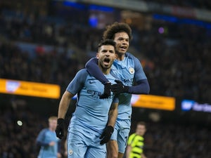 Sergio Aguero celebrates with Leroy Sane after scoring a penalty during the FA Cup replay between Manchester City and Huddersfield Town on March 1, 2017