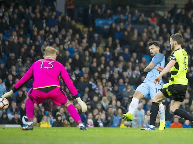 Sergio Aguero scores during the FA Cup replay between Manchester City and Huddersfield Town on March 1, 2017