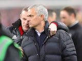 Manchester United manager Jose Mourinho and captain Wayne Rooney celebrate after winning the EFL Cup against Southampton at Wembley on February 26, 2017