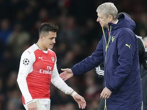 Arsene Wenger subs off Alexis Sanchez during the Champions League game between Arsenal and Bayern Munich on March 7, 2017