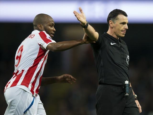 Stoke City's Saido Berahino grabs the arm of referee Neil Swarbrick during the Premier League match against Manchester City on March 8, 2017