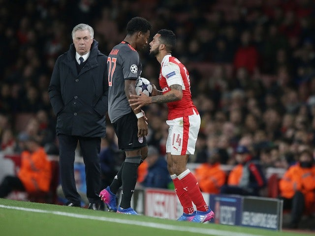 Theo Walcott squares up to David Alaba during the Champions League game between Arsenal and Bayern Munich on March 7, 2017