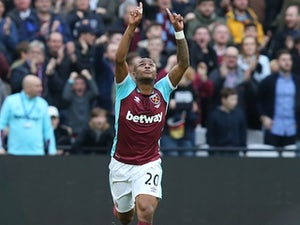 Andre Ayew celebrates scoring during the Premier League game between West Ham United and Leicester City on March 18, 2017