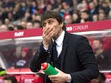Antonio Conte cleans his face during the Premier League game between Stoke City and Chelsea on March 18, 2017
