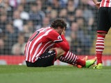 Manolo Gabbiadini lies injured during the Premier League game between Tottenham Hotspur and Southampton on March 19, 2017