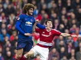 Marouane Fellaini and Marten de Roon in action during the Premier League game between Middlesbrough and Manchester United on March 19, 2017