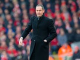Swansea City manager Paul Clement watches on during his side's Premier League clash with Liverpool at Anfield on January 21, 2017
