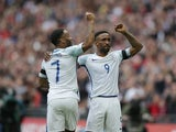 Raheem Sterling and Jermain Defoe celebrate during the World Cup qualifier between England and Lithuania on March 26, 2017