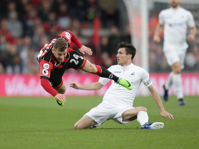 Ryan Fraser and Jack Cork in action during the Premier League game between Bournemouth and Swansea City on March 18, 2017