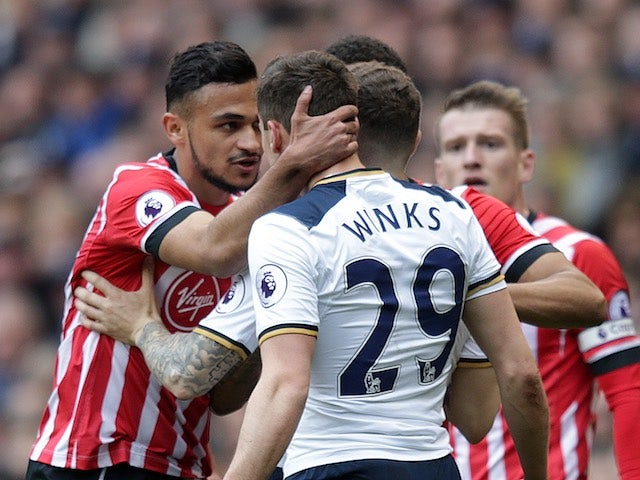 Sofiane Boufal clashes with Harry Winks during the Premier League game between Tottenham Hotspur and Southampton on March 19, 2017