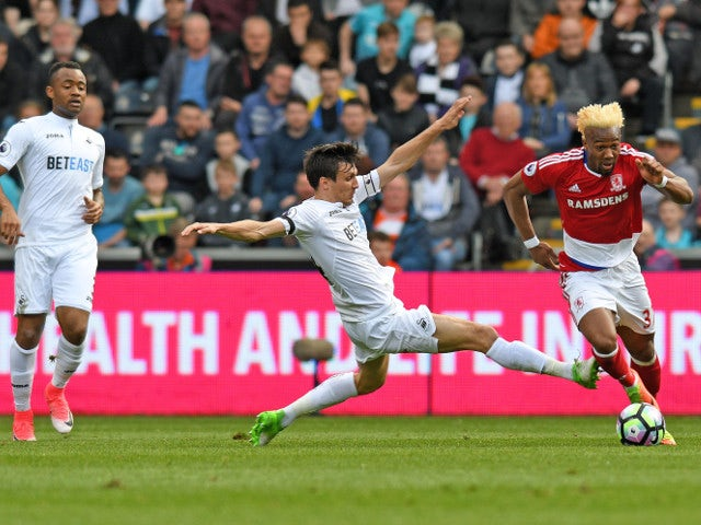 Middlesbrough winger Adama Traore runs with the ball during his side's Premier League clash with Swansea City at the Liberty Stadium on April 2, 2017