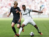 Juventus's Alex Sandro and West Ham United's Martin Samuelson in a pre-season friendly on August 7, 2016