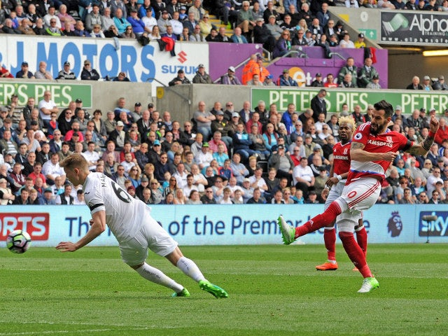 Middlesbrough striker Alvaro Negredo sees a shot blocked by Alfie Mawson during the Premier League clash with Swansea City at the Liberty Stadium on April 2, 2017