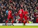 Divock Origi celebrates scoring during the Premier League game between Liverpool and Everton on April 1, 2017