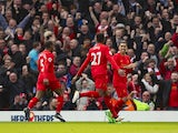 Divock Origi celebrates scoring during the Premier League game between Liverpool and Everton on April 1, 2017