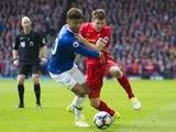 James Milner and Mason Holgate in action during the Premier League game between Liverpool and Everton on April 1, 2017