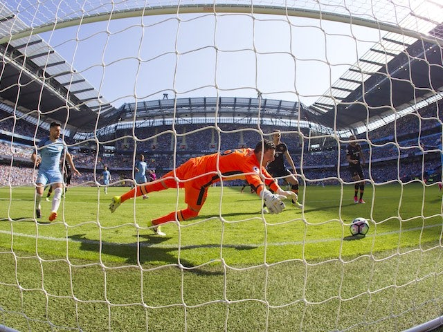 Ahmed Elmohamady scores an own goal past Eldin Jakupovic during the Premier League game between Manchester City and Hull City on April 8, 2017