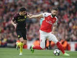 Jesus Navas and Olivier Giroud in action in the Premier League game between Arsenal and Manchester City on April 2, 2017