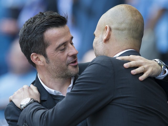 Marco Silva and Pep Guardiola embrace ahead of the Premier League game between Manchester City and Hull City on April 8, 2017