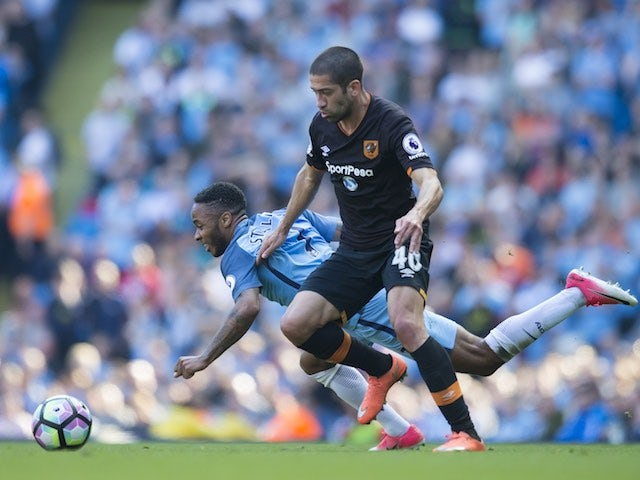 Raheem Sterling and Evandro in action during the Premier League game between Manchester City and Hull City on April 8, 2017
