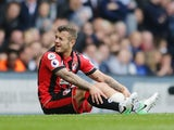 Jack Wilshere sits injured during the Premier League game between Tottenham Hotspur and Bournemouth on April 15, 2017