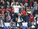 Mousa Dembele celebrates scoring during the Premier League game between Tottenham Hotspur and Bournemouth on April 15, 2017