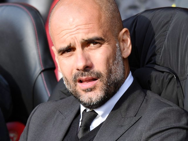 Pep Guardiola watches on during the Premier League game between Southampton and Manchester City on April 15, 2017`