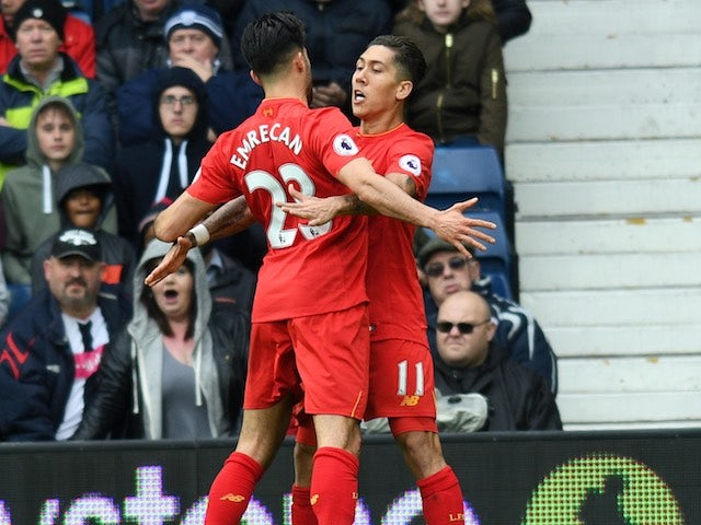 Roberto Firmino celebrates scoring with Emre Can during the Premier League game between West Bromwich Albion and Liverpool on April 16, 2017