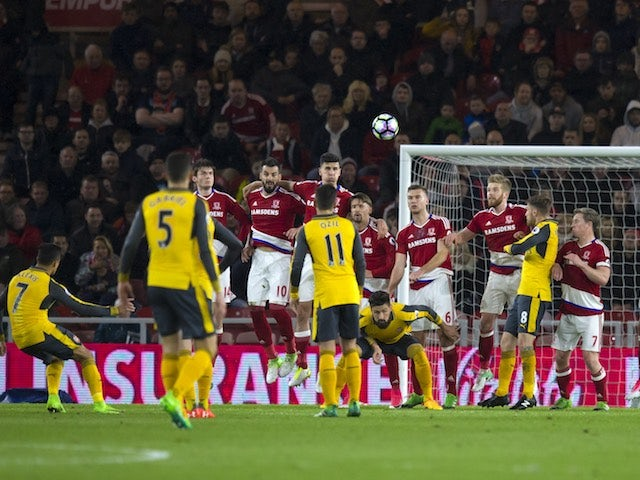 Alexis Sanchez scores during the Premier League game between Middlesbrough and Arsenal on April 17, 2017