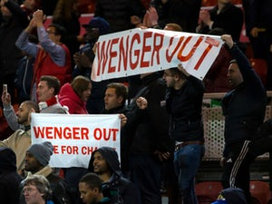 Arsenal fans hold up 'Wenger Out' signs during the Premier League clash with Middlesbrough at the Riverside Stadium on April 17, 2017