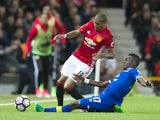 Manchester United's Ashley Young is tackled by Everton's Idrissa Gueye on April 4, 2017