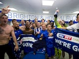Brighton & Hove Albion players celebrate promotion to the Premier League on April 17, 2017