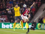Fabio and Mesut Ozil in action during the Premier League game between Middlesbrough and Arsenal on April 17, 2017