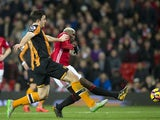 Harry Maguire and Paul Pogba during the Premier League match between Hull City and Manchester United on February 1, 2017