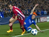 Jamie Vardy tussles with Diego Godin during the Champions League quarter-final second leg between Leicester City and Atletico Madrid on April 18, 2017