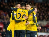 Arsenal midfielder Mesut Ozil celebrates with Granit Xhaka and Aaron Ramsey after scoring during the Premier League clash with Middlesbrough at the Riverside Stadium on April 17, 2017