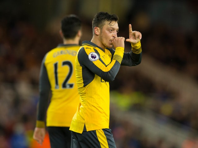 Arsenal midfielder Mesut Ozil celebrates after scoring during his side's Premier League clash with Middlesbrough at the Riverside Stadium on April 17, 2017