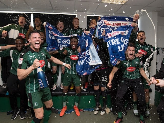 Plymouth Argyle players celebrate promotion to League One on April 17, 2017