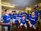 Portsmouth players celebrate promotion to League One on April 17, 2017