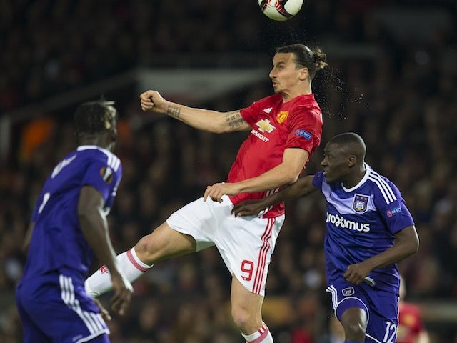 Zlatan Ibrahimovic tussles with Dennis Appiah and Kara Mbodji during the Europa League game between Manchester United and Anderlecht on April 20, 2017