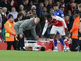 Arsenal manager Arsene Wenger appeals to the referee as Alexis Sanchez reacts in pain during the Premier League match against Leicester City on April 26 2017