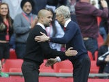 Arsenal's Arsene Wenger offers a hand to Manchester City's Pep Guardiola following the FA Cup semi-final on April 23, 2017