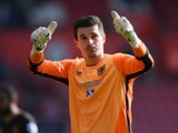 Hull City's Eldin Jakupovic gives a thumbs-up to the crowd after saving a late penalty in the Premier League match against Southampton on April 29, 2017