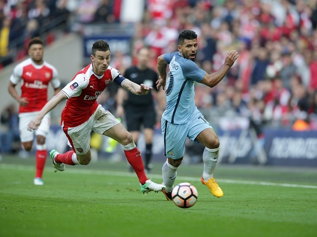 Arsenal's Laurent Koscielny and Manchester City's Sergio Aguero during the FA Cup semi-final on April 23, 2017