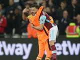 West Ham United's Adrian and Robert Snodgrass celebrate victory over Tottenham Hotspur on May 5, 2017